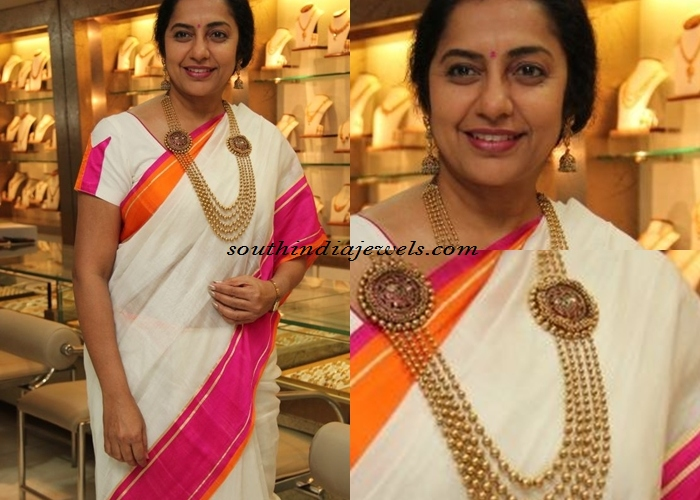 Suhasini in multilayer gold long necklace