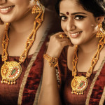 Actress Kavya Madhavan in Traditional Gold Jewelleries