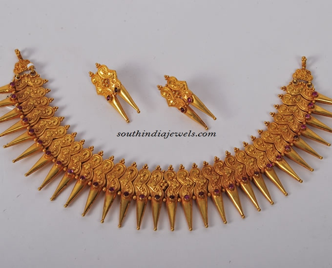 Gold spike necklace