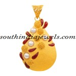 Latest Gold Jewellery Designs : Pearl and ruby pendant