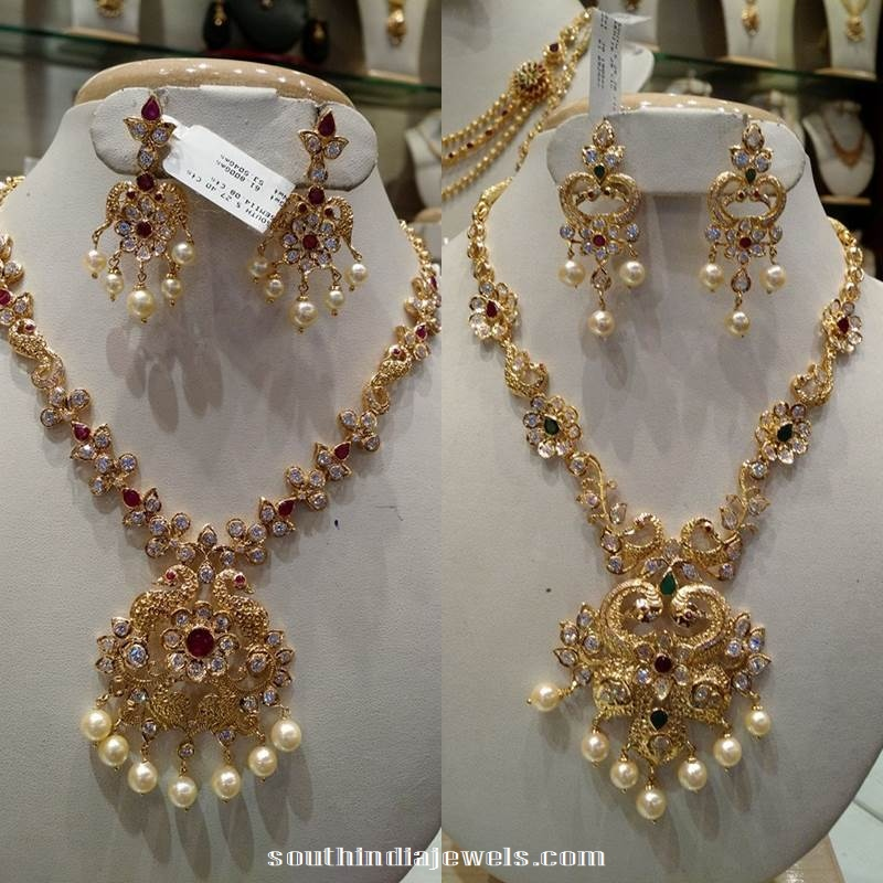 Gold White Stone Peacock Necklace with Chandbali earrings