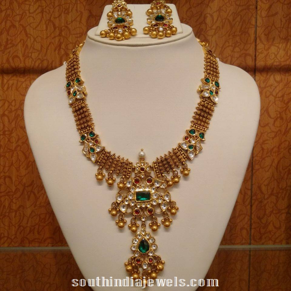 Gold antoque emerald polki necklace design