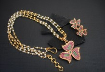 Multi layer pearl chain with AD studded floral pendant