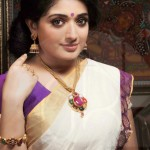 Kavya Madhavan in Navarathna Necklace Set