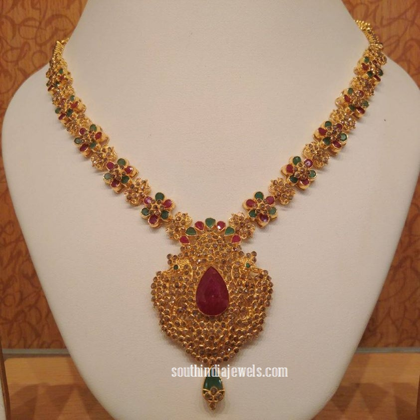 Gold floral ruby emerald necklace from NAJ