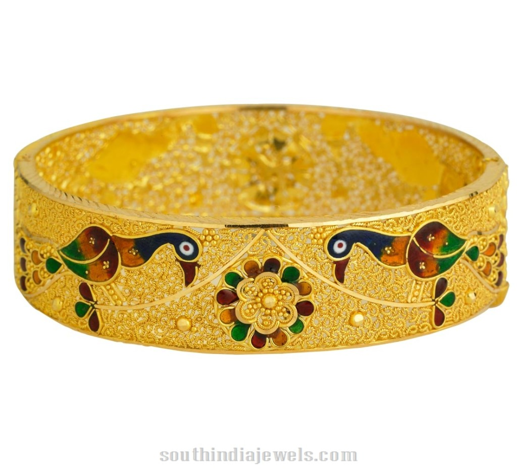 Gold peacock bangle from Kerala Jewellers