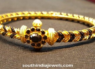 22k gold bangle with black stones and beads
