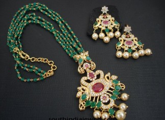 Imitation emerald mala with emerald pearl earrings from Magha Store