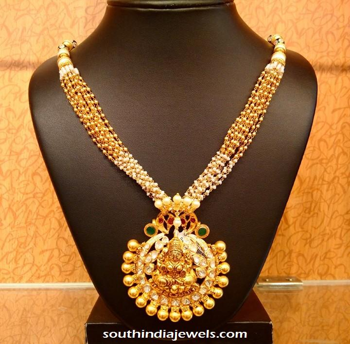 Gold designer pearl mala with temple pendant