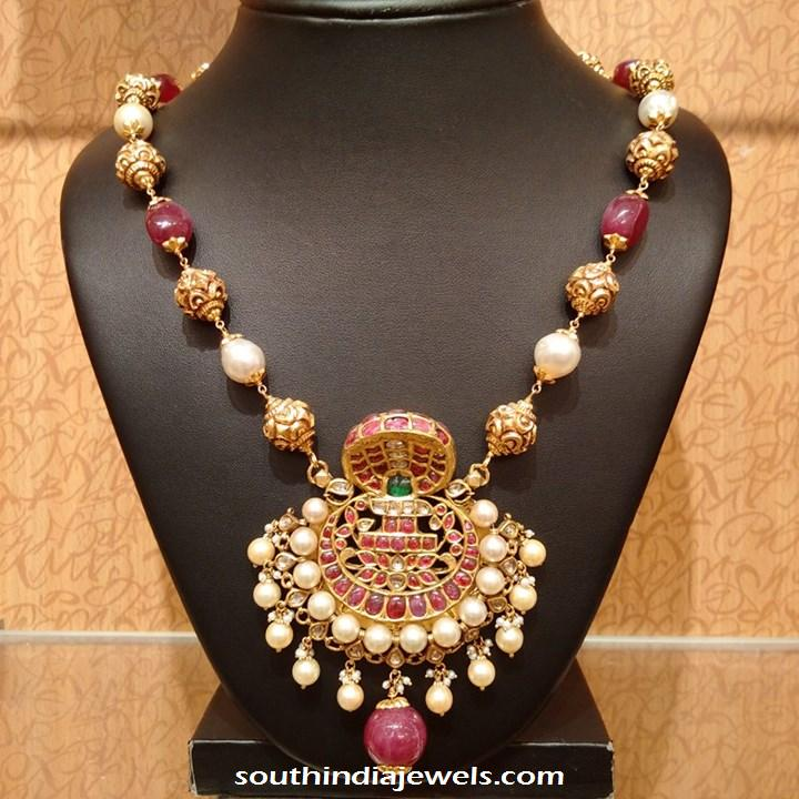 Gold ruby pearl necklace with antique naga pendant