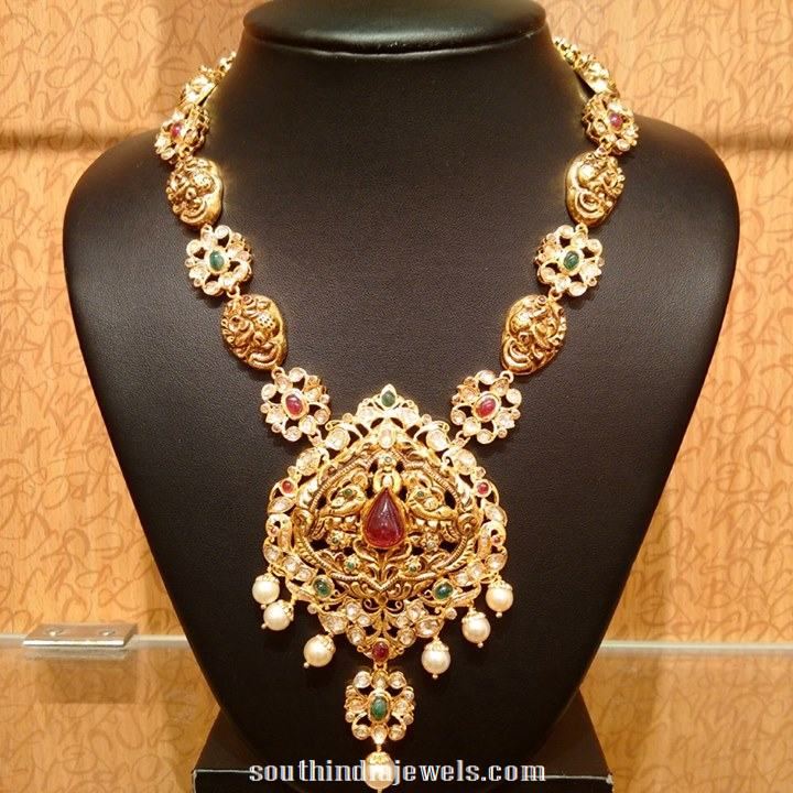 Gold Nakshi work peacock long necklace