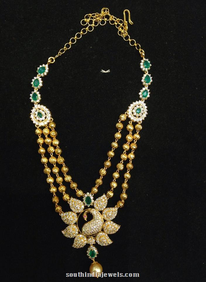 Gold Peacock Step Necklace with CZ stones