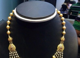 Multilayer gold pearl necklace design