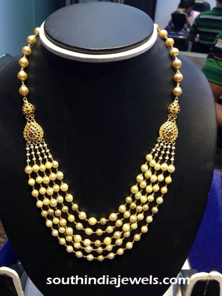 Multilayer gold pearl necklace design