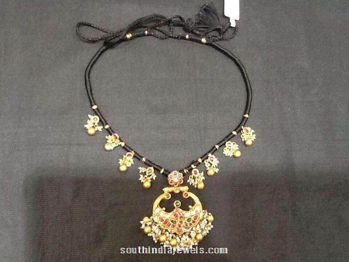 Gold black thread necklace design