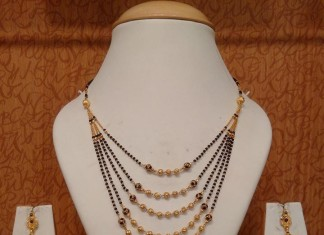 22k gold black bead mala step necklace