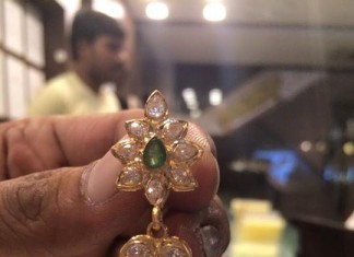 Gold Jhumka with green stone and pearls