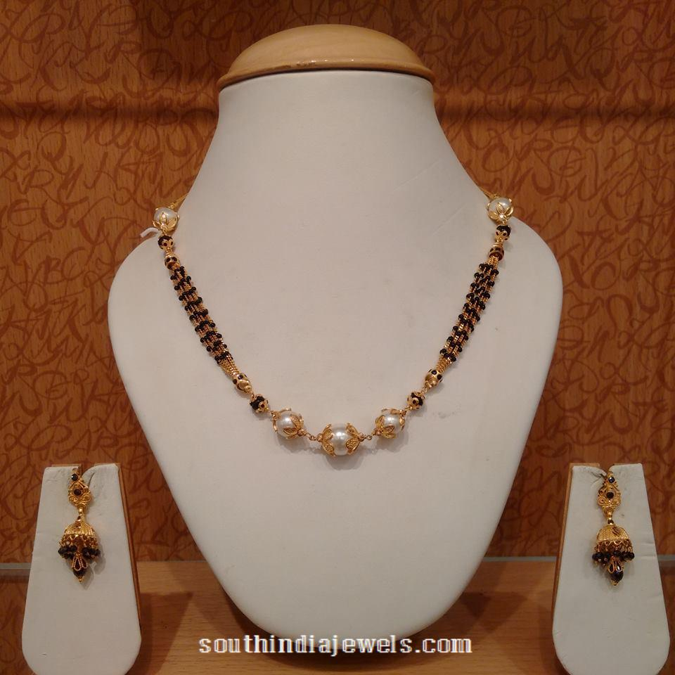Gold short black bead necklace