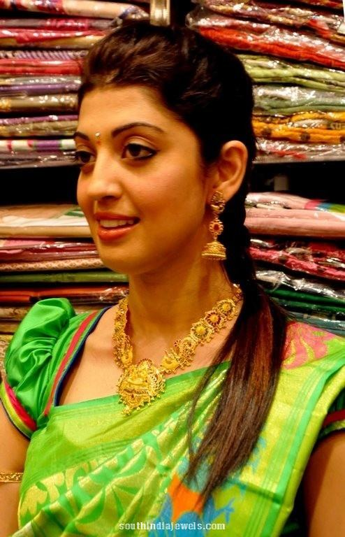 Pranitha Subhash gold necklace and jhumka