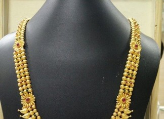 Gold long haram with floral pendant