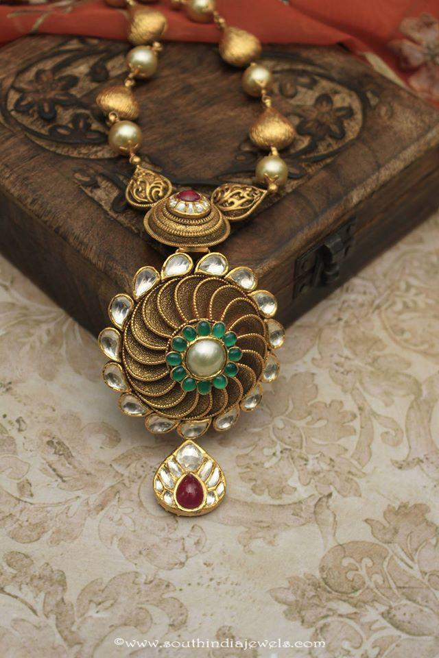 Dull Finish Gold Antique Necklace set from Manubhai Jewellers