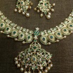 Gold Emerald Mango Mala from Dhanlaxmi Jewellers