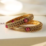 Gold Bangles with Pink Stones from Manubhai
