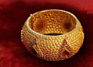 Bold Gold Bangle With Red Stones