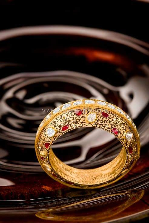 Gold Designer Bangle With Red Stones