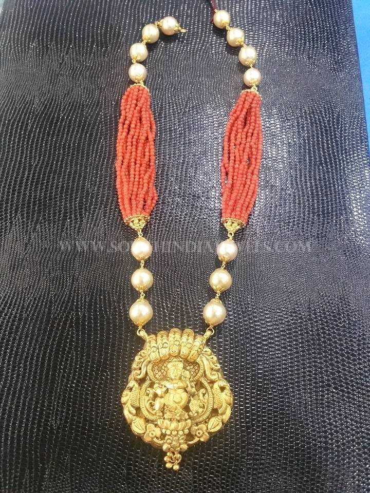 Gold Coral Necklace With Temple Pendant