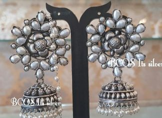 Silver oxidized pearl jhumka with pearl maatal.