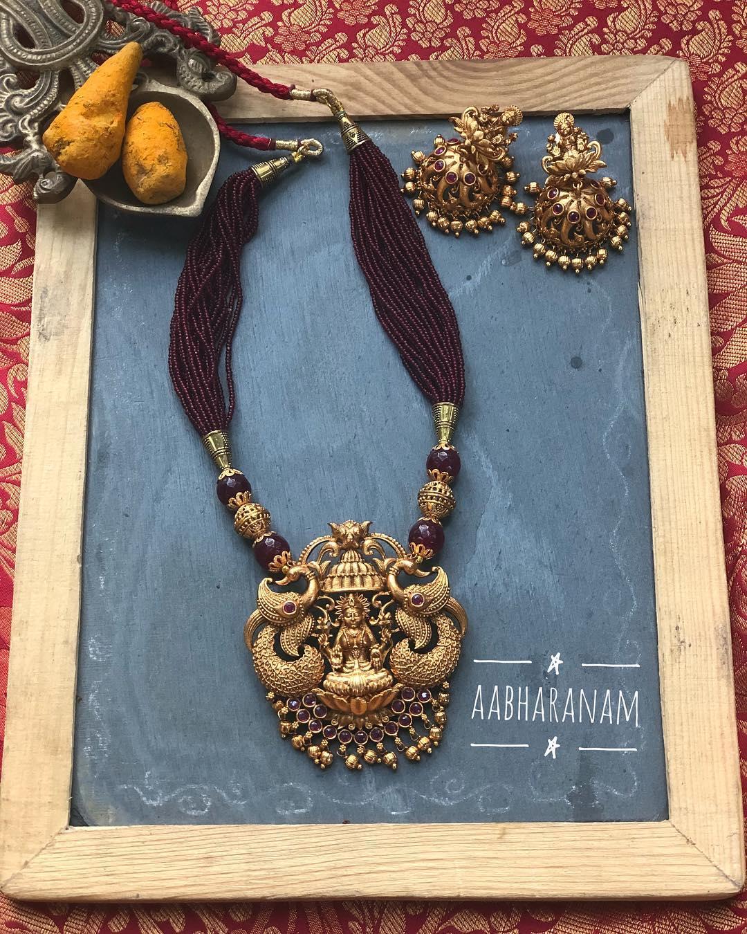 Antique Gold Finish lLakshmi Necklace From Abharanam