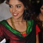 Actress Asin wearing gold Kasumalai
