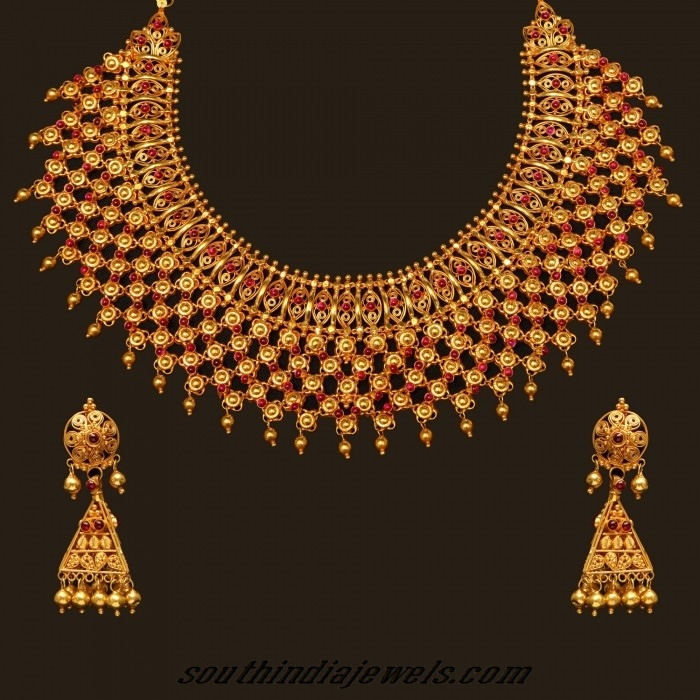 Gold choker necklace set with earrings