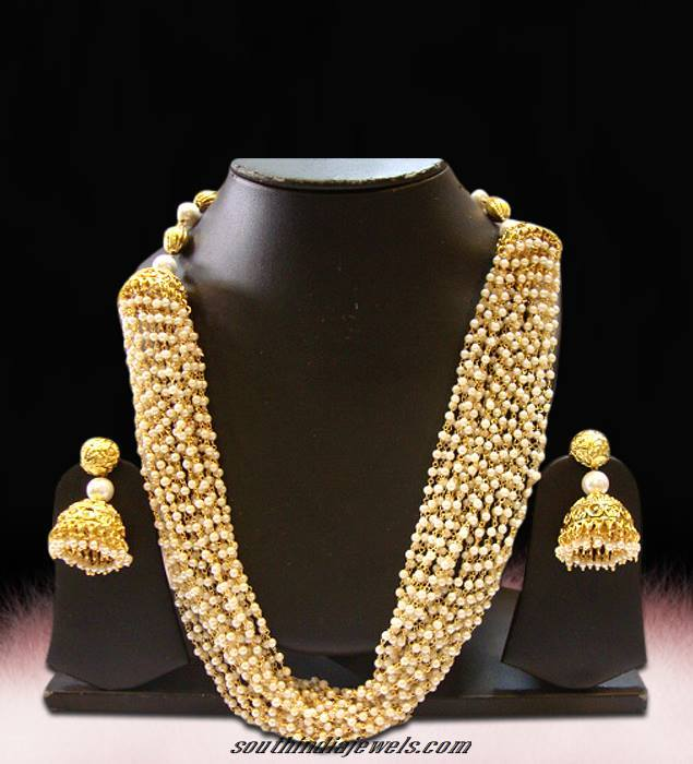 Multilayer pearl mala set with matching jhumka