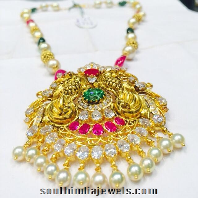 Yellow gold pearl mala with peacock pendant