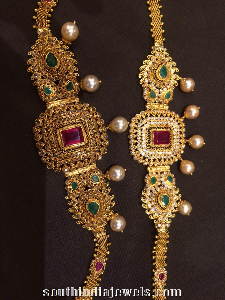 gold arm band with rubies, emeralds and southsea pearls