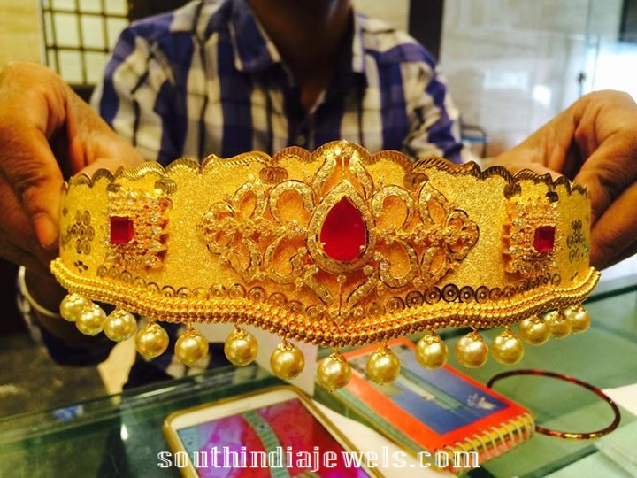 22kl gold baby vaddanam with emearlds and south sea pearls
