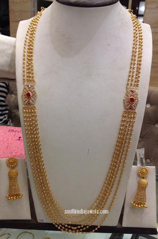 Gold Gundala Haram wth side mogappu and earrings