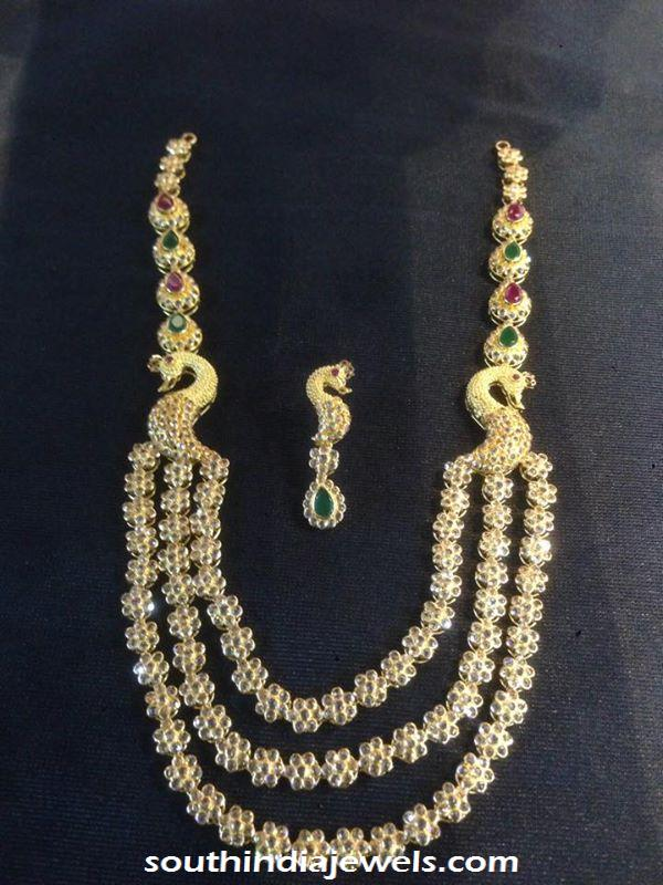 Gold three layer stone peacock necklace