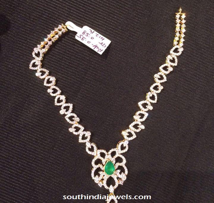 Diamond necklace with emerald pendant