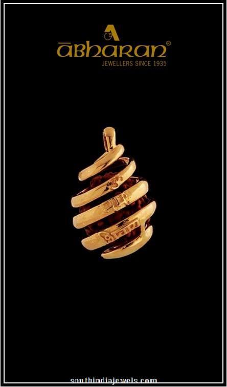 Gold tear drop shaped pendant