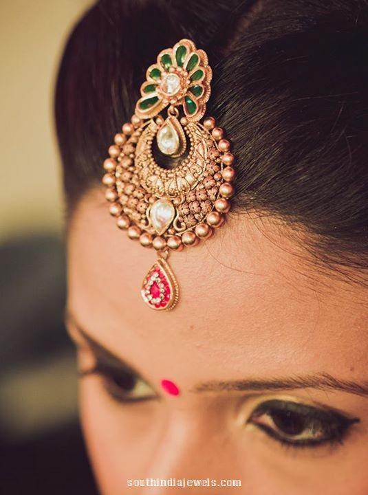 Gold Antique tikka from Manubhai Jewellers