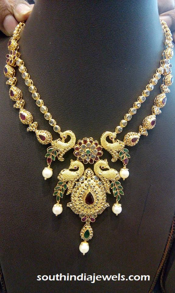 Two layer gold peacock step necklace