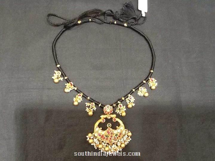 Gold black thread necklace design