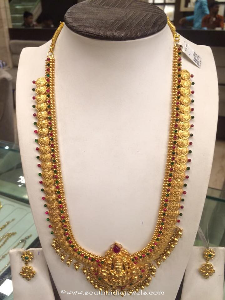 Gold long temple kasumalai with earrings
