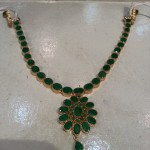 Gold Emerald Attigai from Shubham Jewellers