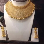Broad Gold Designer Choker and Earrings