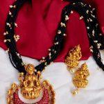 Black Beaded Necklace Set With Goddess Lakshmi Pendant
