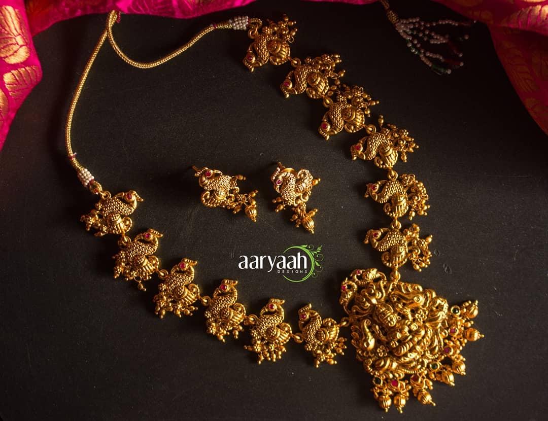 matte-gold-alike-laxmi-peacock-temple-necklace-set